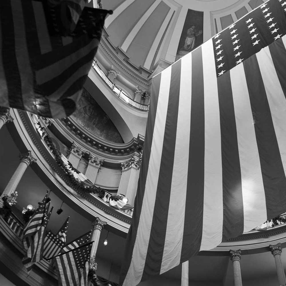 american flag hanging in a court house